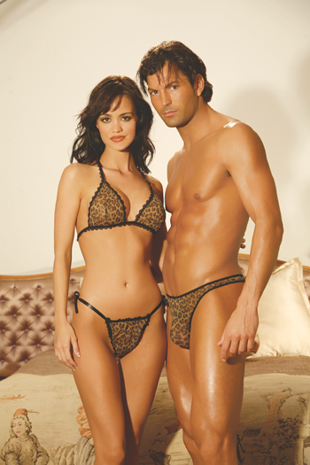 Man and woman wearing leopard thong.