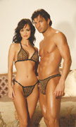 Man and woman with a leopard thong set on.